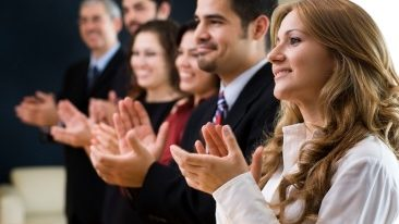 applauding-business-people